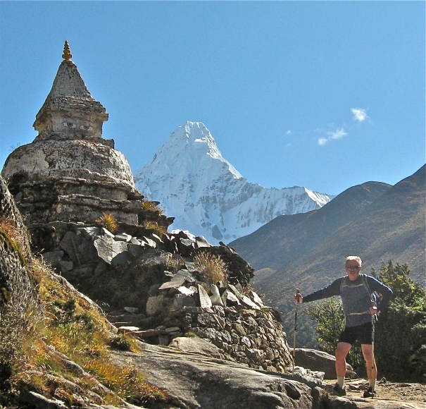 Ned Ellis pauses before moving past a Buddhist shrine near Ama Dablam.