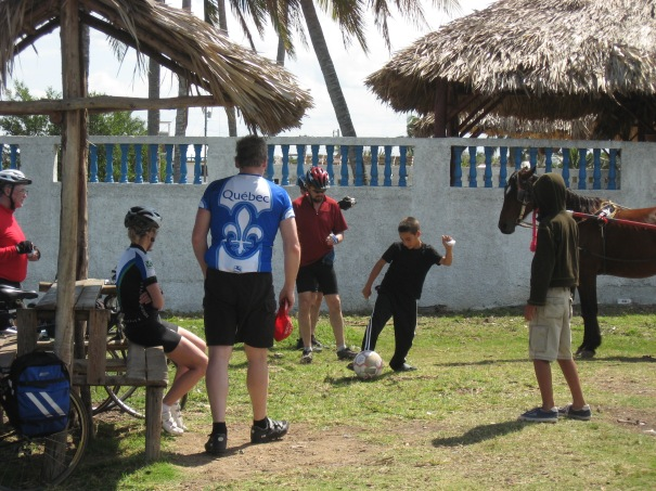 Cyclists and Cubans mix it up with a game of soccer. Doug Taylor  (in red shirt) supplied the ball.