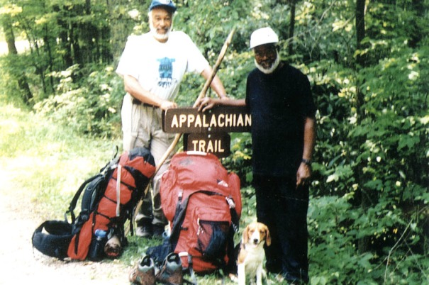 Ralph and Sarge, Romelis Ellis, and their trail companion.