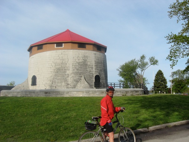 Doug Taylor stops in front of round structure, part of the extensive fortifications of Kingston.
