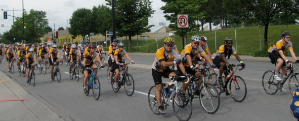 Cyclists ride along Notre Dame Street in cancer event.