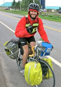 ANDREW ALFORD PEDALS ALONG HIGHWAY 132 IN QUEBEC